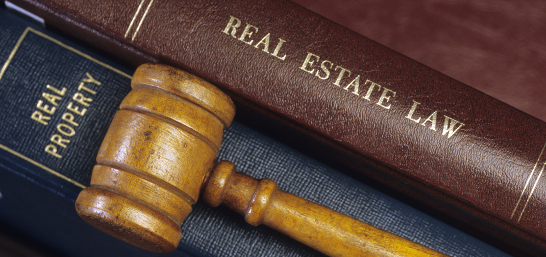 What does a real estate law attorney do